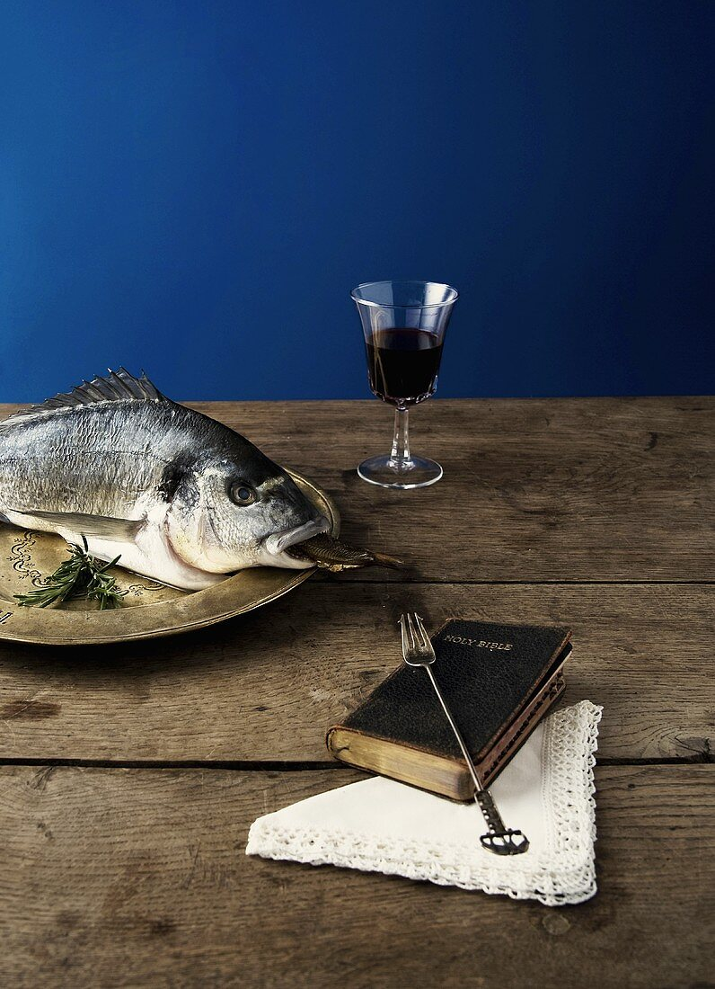 Fish, red wine & Bible (tradition of eating fish on Friday)