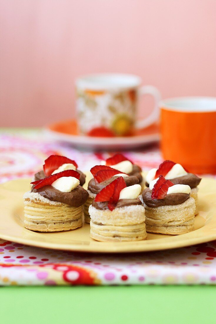Puff pastries with chocolate cream and strawberries