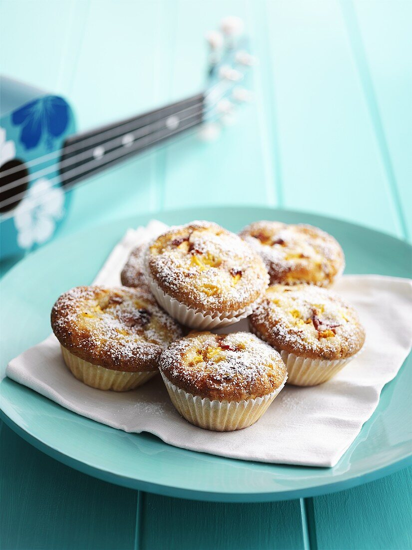 Peach muffins dusted with icing sugar