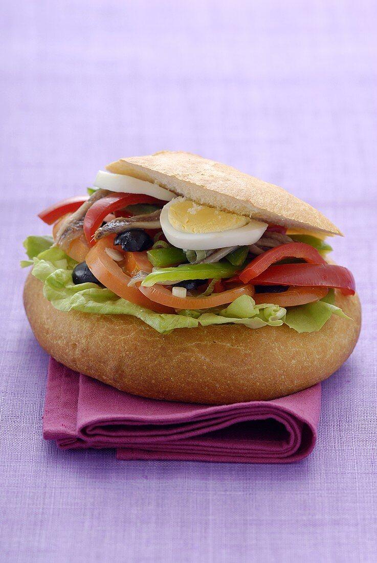 Pan bagnat (Salad, anchovy and egg sandwich, Nice)