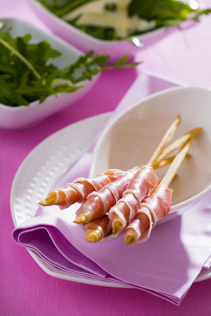 Grissini e prosciutto (Bread sticks wrapped in Parma ham)