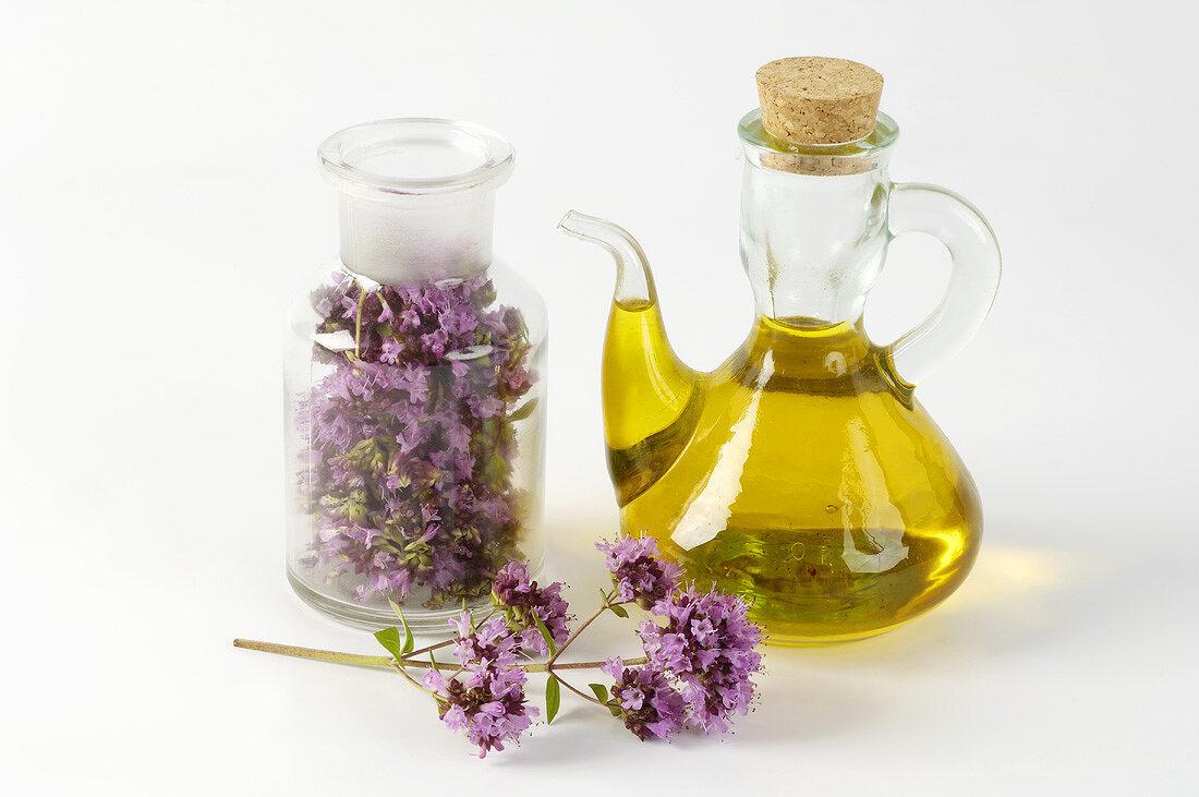 Oregano flowers and oregano oil (herbal remedy)