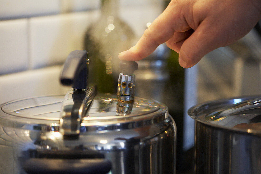 Finger on pressure cooker