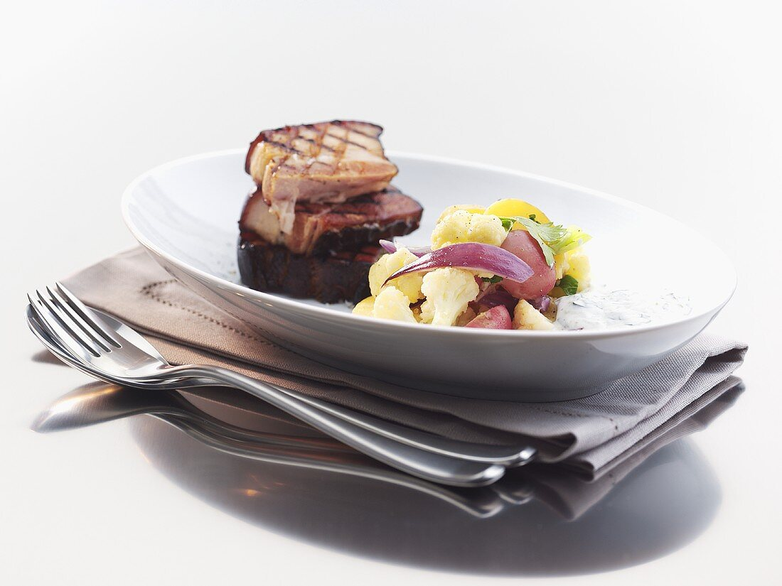 Grilled belly pork with almond potatoes and vegetables