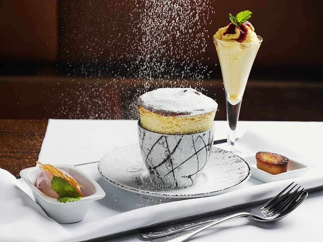 Dusting quark soufflé with icing sugar