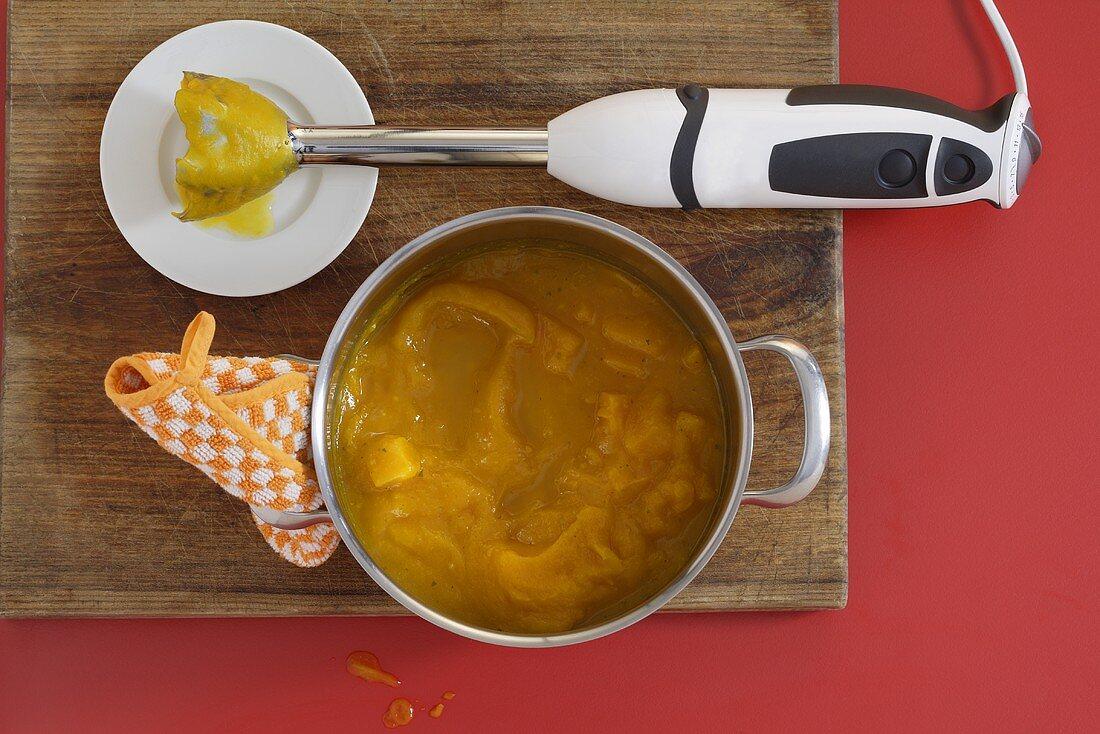 Pumpkin soup with hand blender