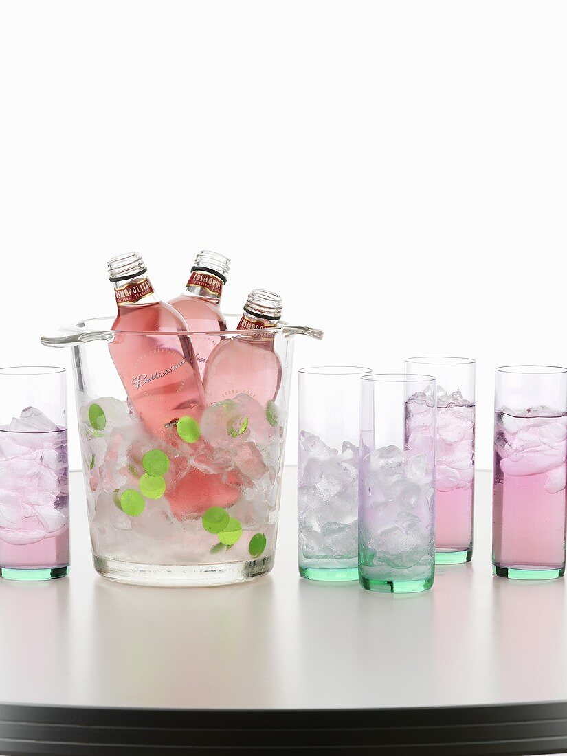Ice cube container, bottles of Cosmopolitan and glasses