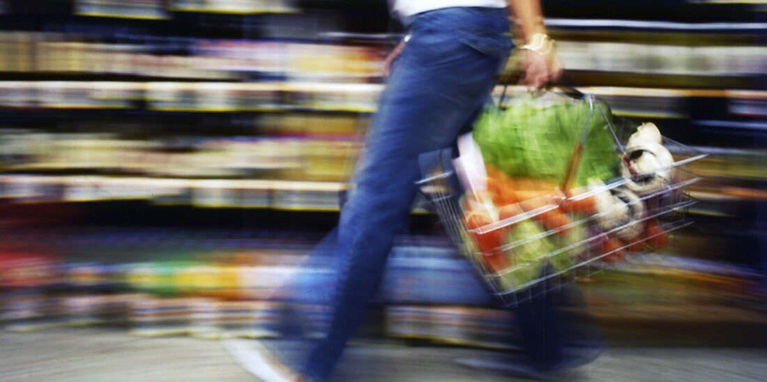 Person with a full shopping basket