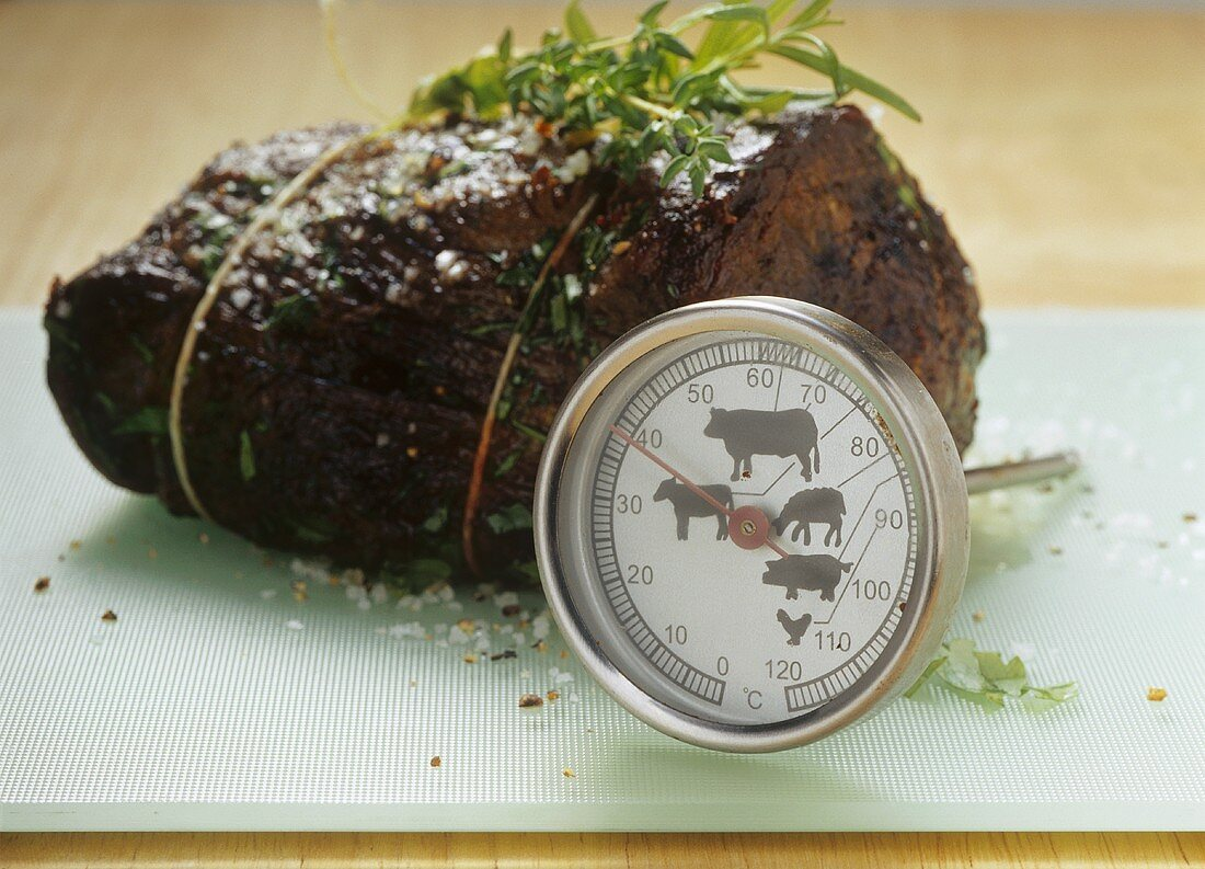 Checking the degree of cooking of beef fillet steak