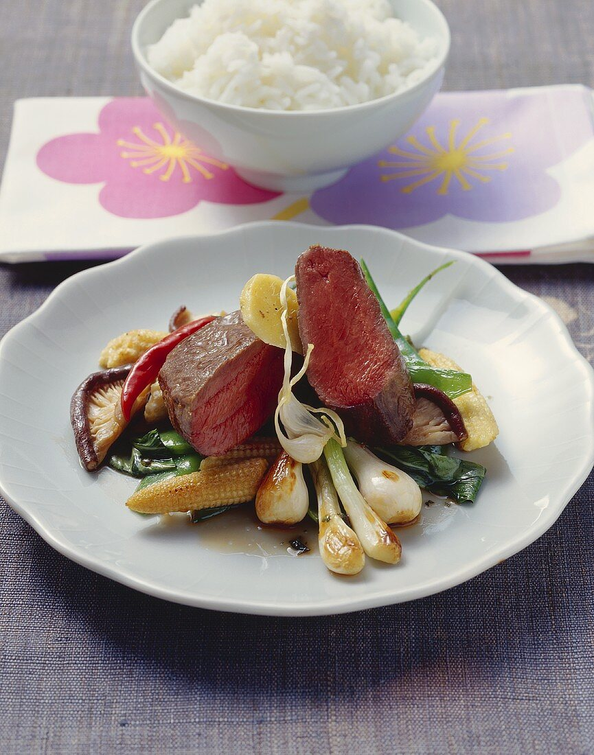 Roast loin of venison (medium rare) with Asian seasonings
