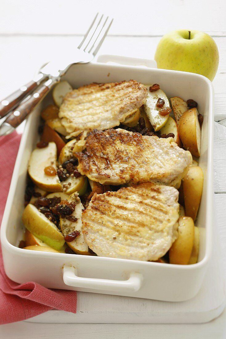 Pork chops with apple wedges and raisins