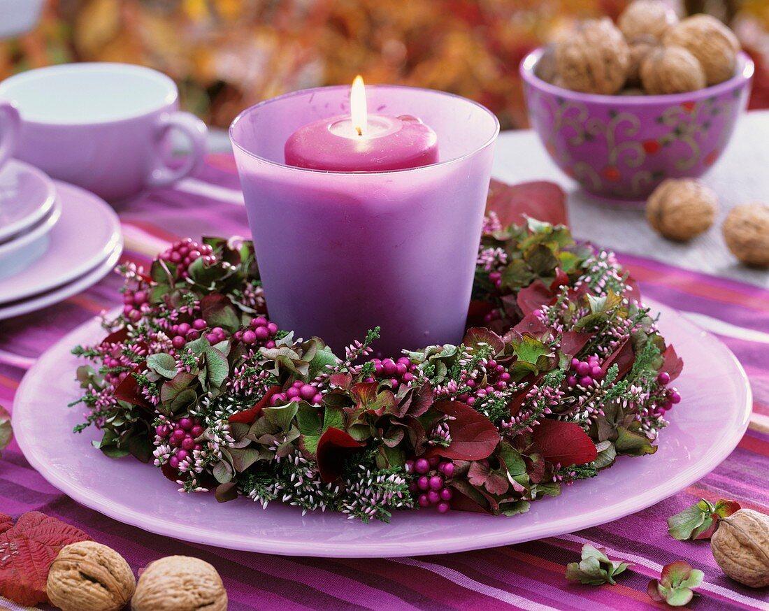 Windlight with wreath of heather, hydrangeas, beauty berries