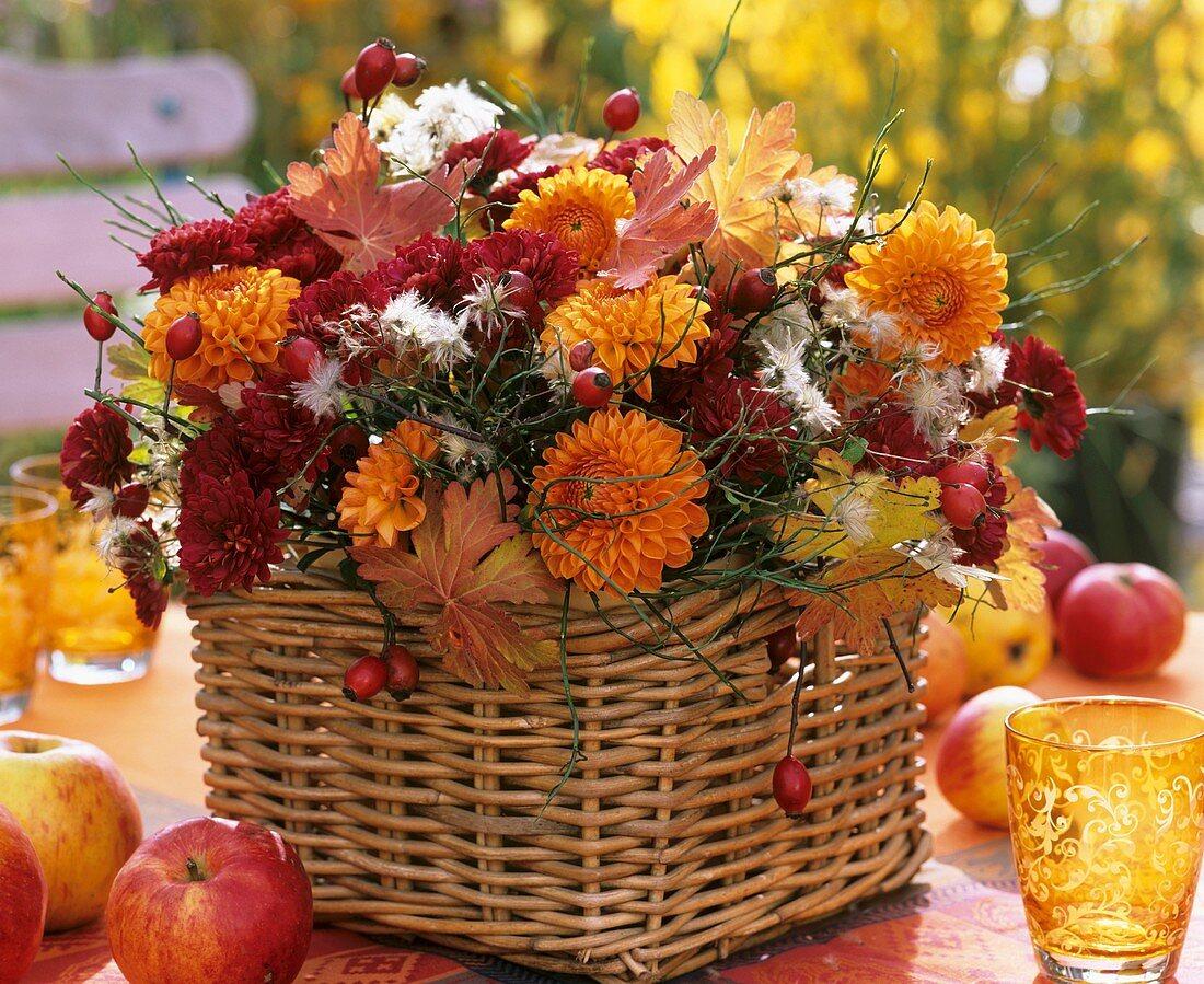 Arrangement of dahlias & chrysanthemums in rectangular basket