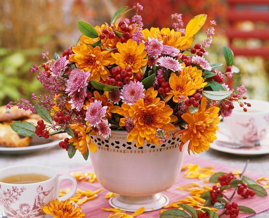 Arrangement of chrysanthemums on tea table