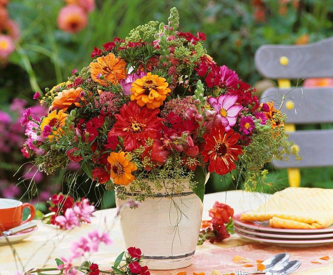 Colourful arrangement of zinnias, cosmos, sweet williams