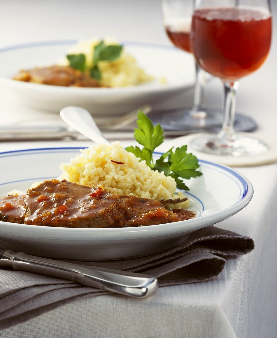 Veal tongue in spicy pepper sauce with couscous