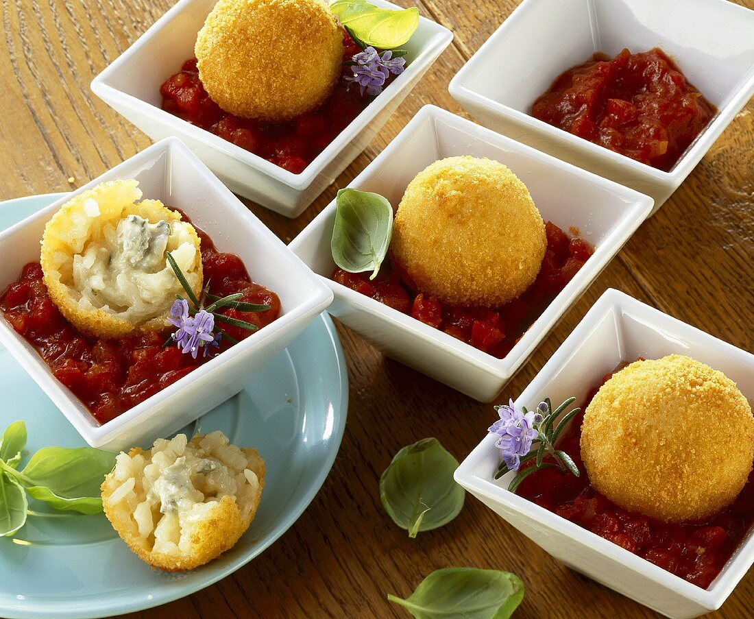 Deep-fried rice balls with tomato dip