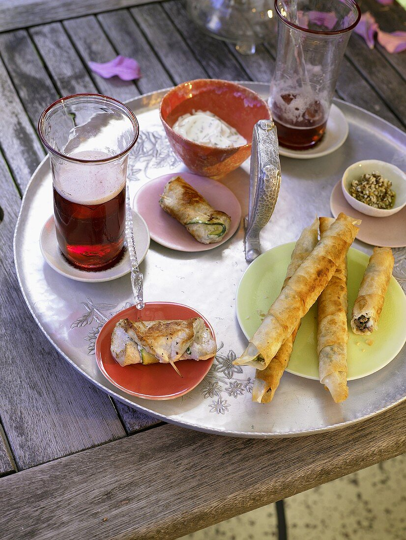 Courgette rolls, yufka pastry rolls with mince & cherry beer