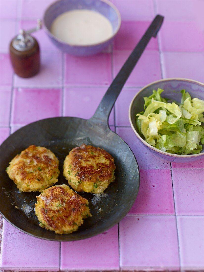 Kaspressknödel (fried cheese dumplings) with endive salad
