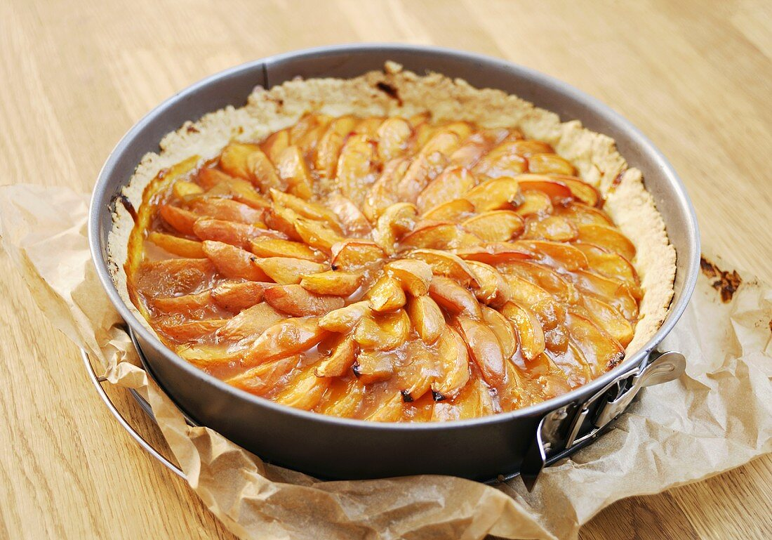Peach tart in the baking tin
