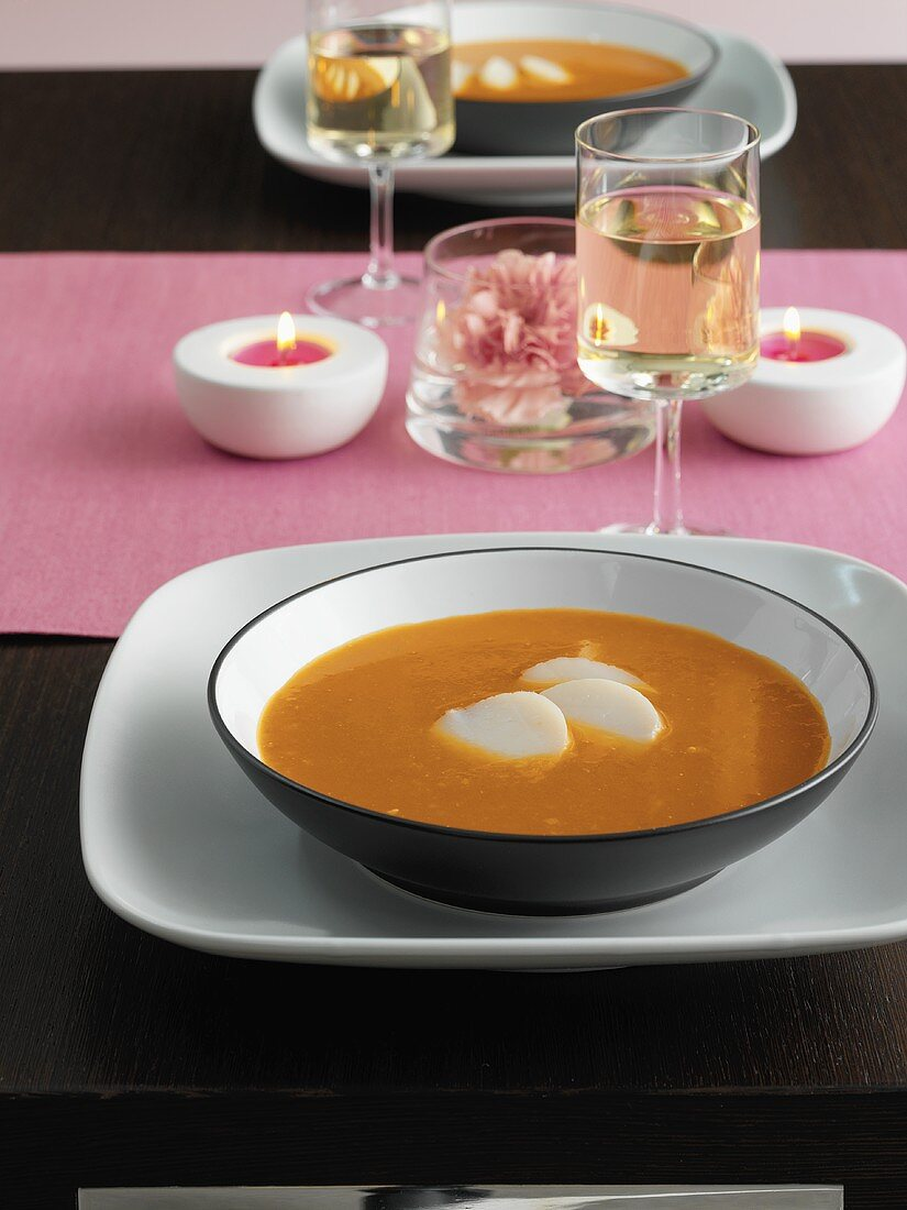 Tomato and orange soup with scallops