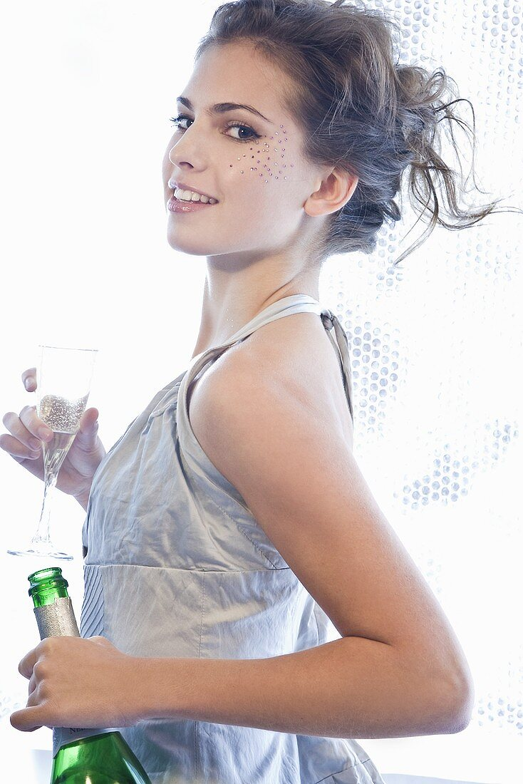 Young woman with champagne in her hand