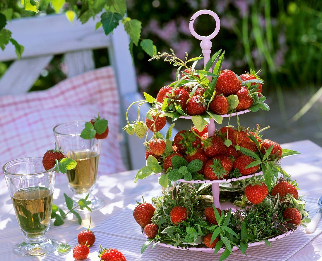 Strawberries and herbs on tiered stand