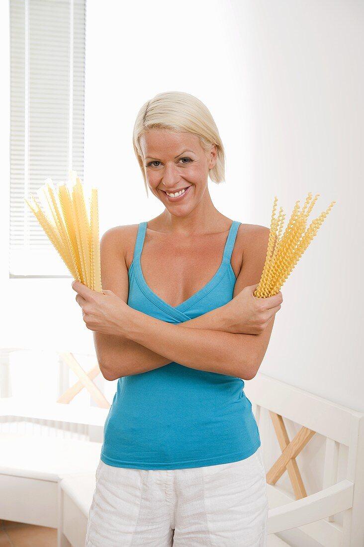 Blond woman with pasta (malfadine & fusilli lunghi bucati)