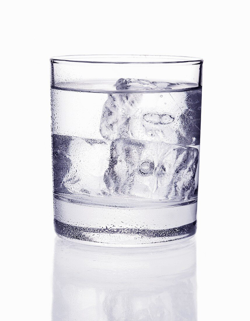 A glass of mineral water with ice cubes