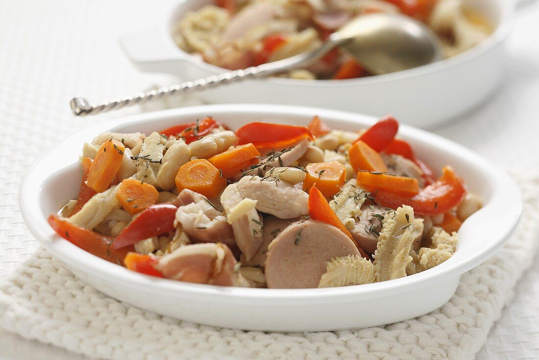 Tripe with strips of red pepper, carrots and sausage