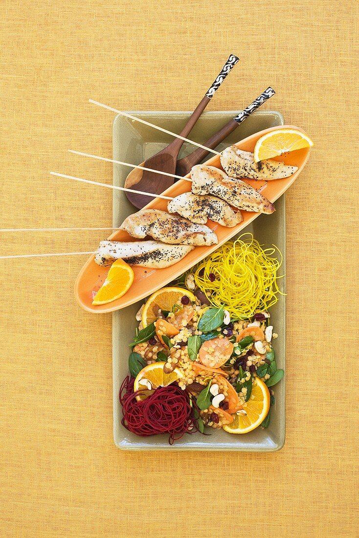 Chicken skewers with lentil salad and orange slices
