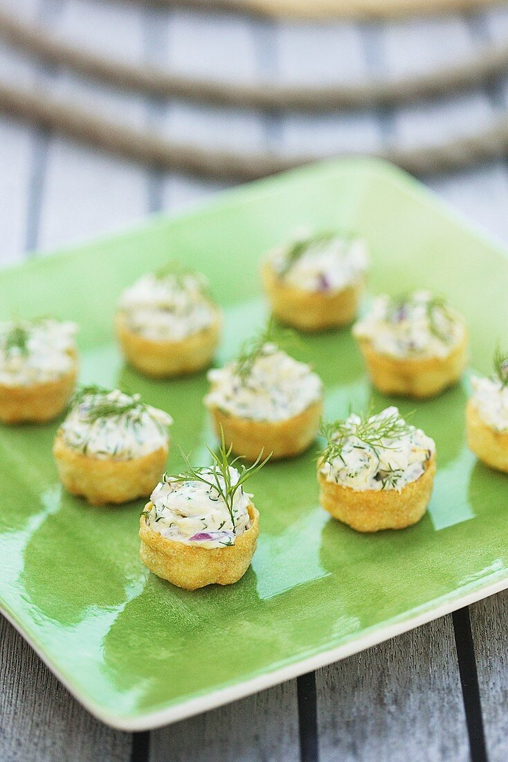 Pastry shells filled with tuna cream