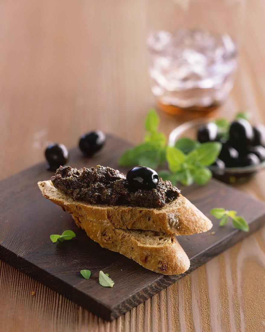 Black olive paste on onion baguette