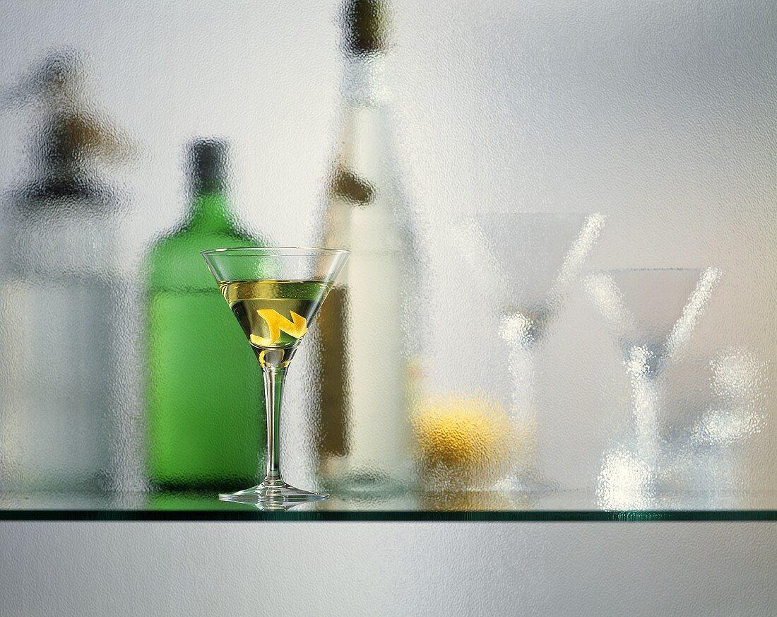 Bar still life: Martini, soda syphon, drinks, cocktail glasses