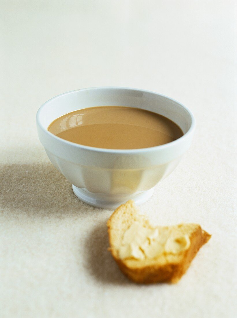 Café au lait and a piece of brioche