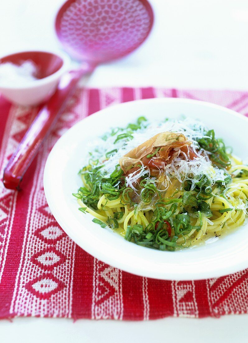 Spaghetti with Parma ham and spring onion rings