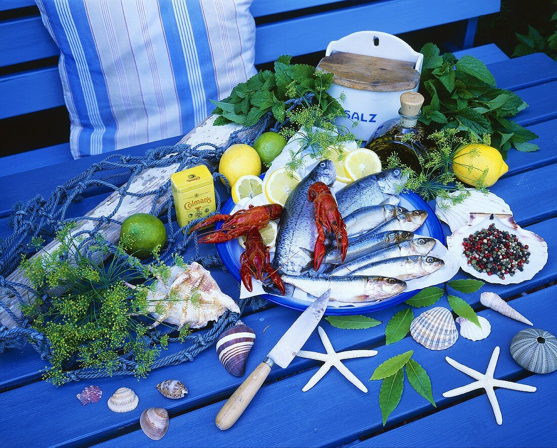Still life with fish, crayfish and herbs