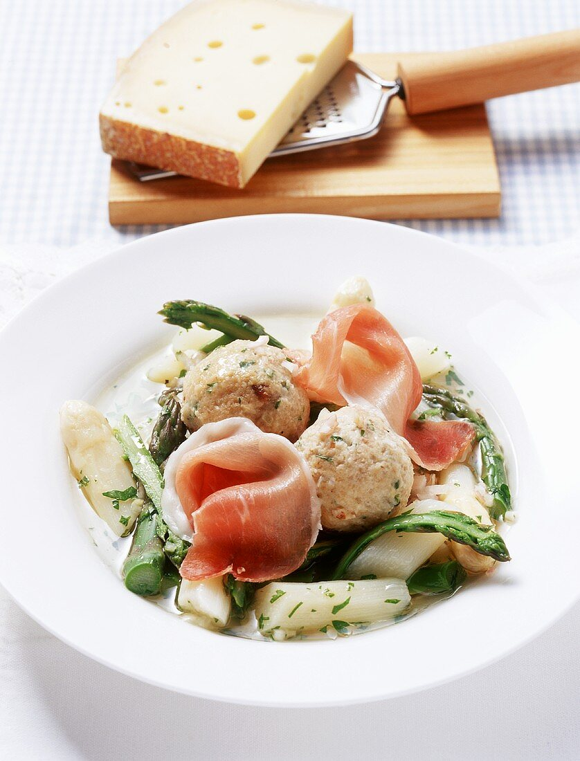 Cheese dumplings with raw ham on marinated asparagus