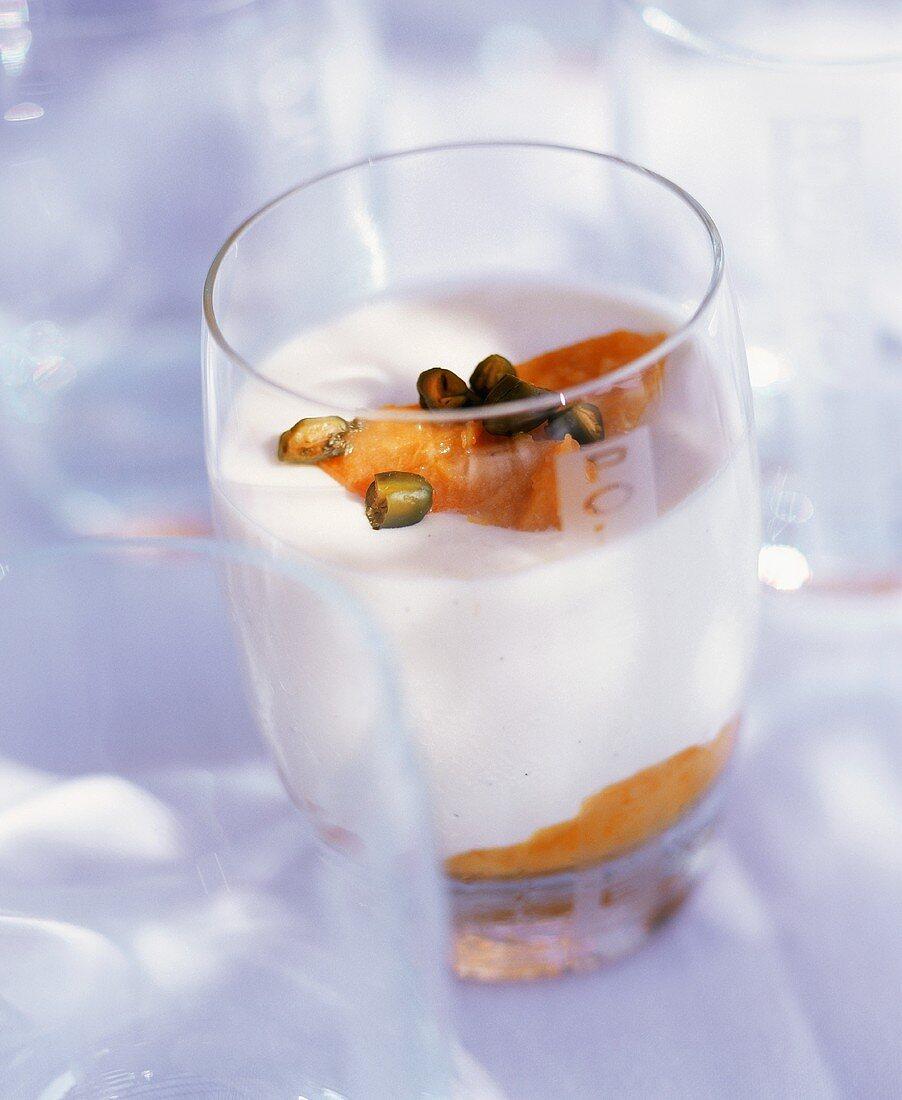 Yogurt dessert with fruit and pistachios