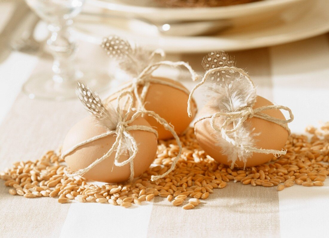 Easter decoration: grains of corn and eggs with feathers