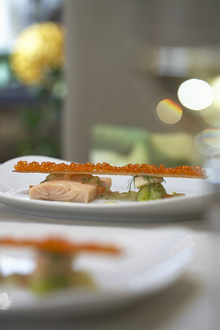 Poached salmon trout with toasted bread and caviar