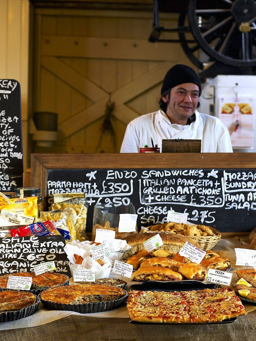 A baker selling his wares at a Farmer's Market in England