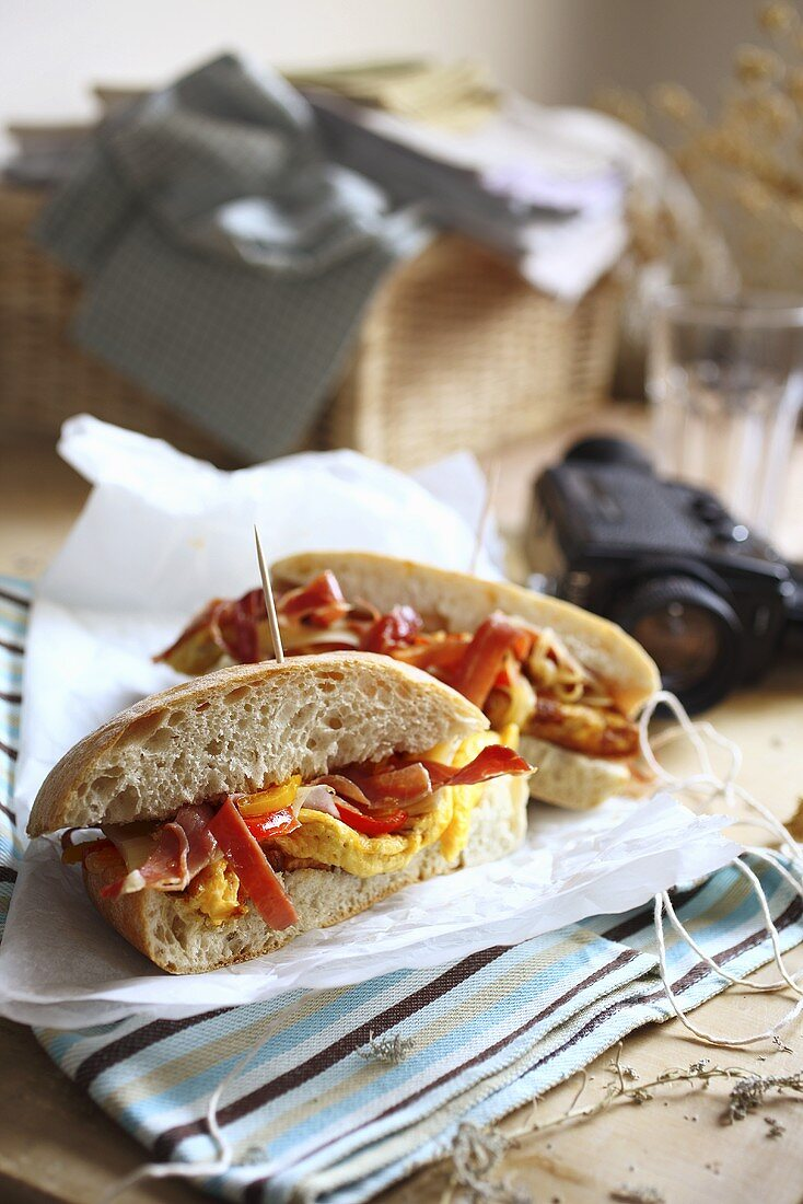 Scrambled egg, bacon, grilled pepper and tomato sandwich