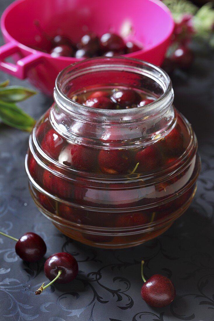 A jar of preserved cherries