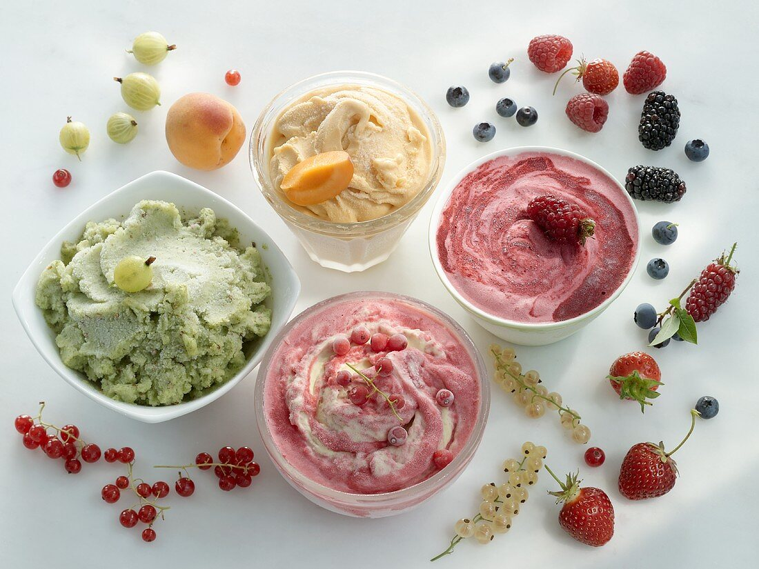 Four different fruit ice creams in bowls