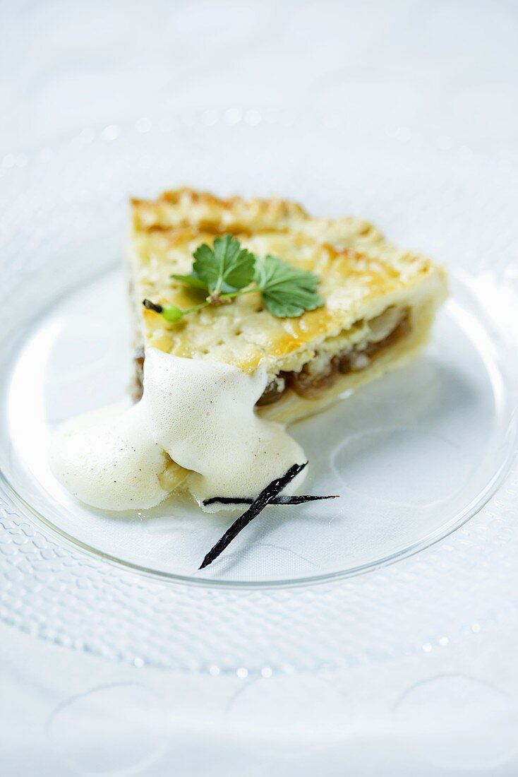 A slice of gooseberry cake with vanilla sauce