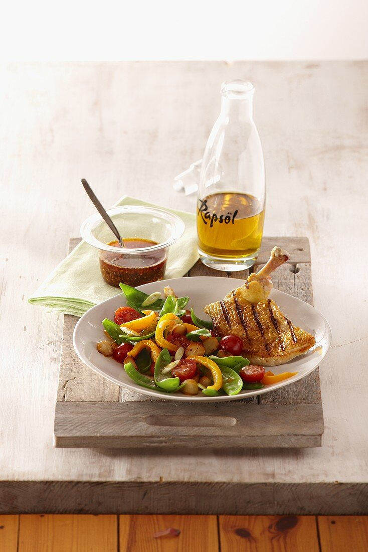 Grilled corn-fed chicken breast in a cajun spice oil with a mange tout salad
