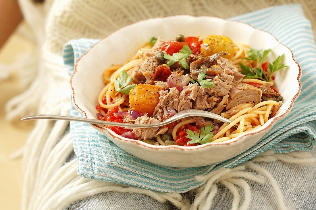Spaghetti with tuna, cherry tomatoes, anchovies and capers