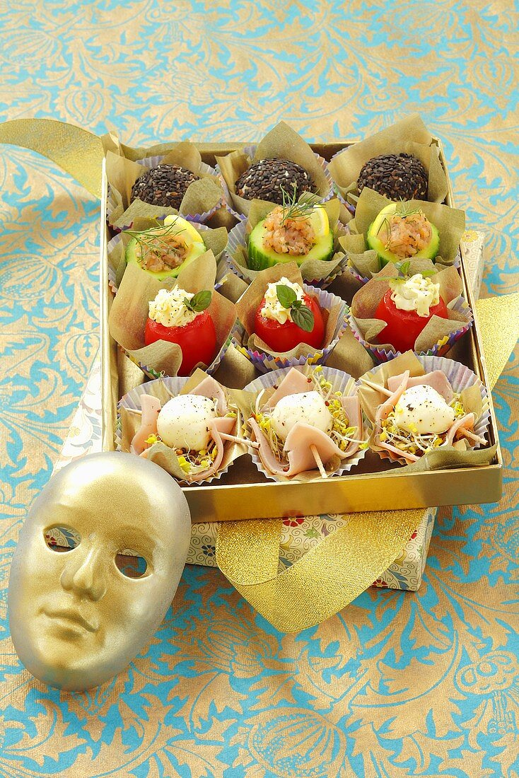 Canapes with mozzarella, tomatoes, gherkins and cream cheese balls