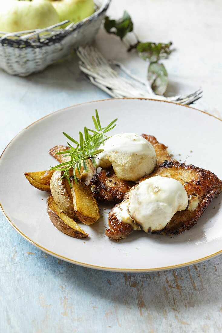 Pork chops with apples and potato wedges